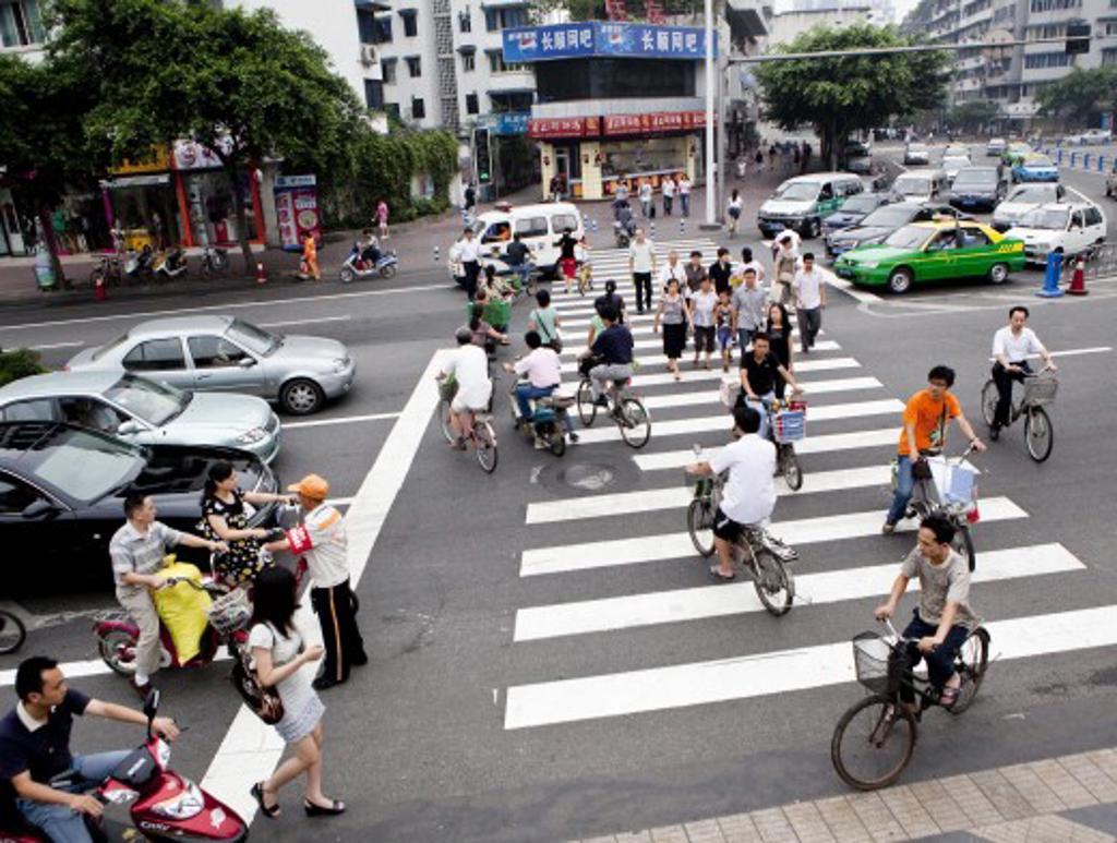 People walking on zebra crossing, Beijing, China : Stock Photo