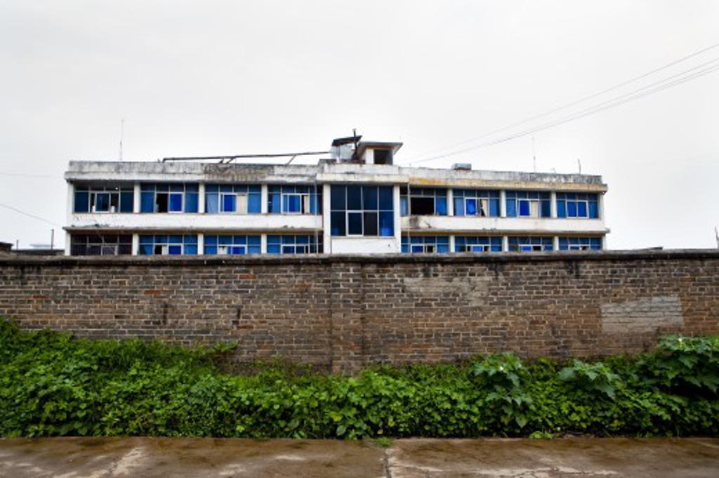 Apartment building along a street, Lijiang, Yunnan Province, China : Stock Photo