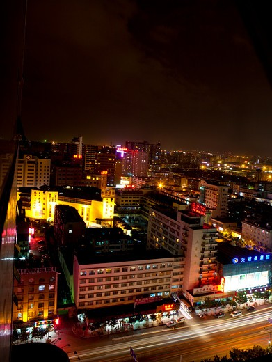Buildings lit up at night, Chengdu, Sichuan Province, China : Stock Photo