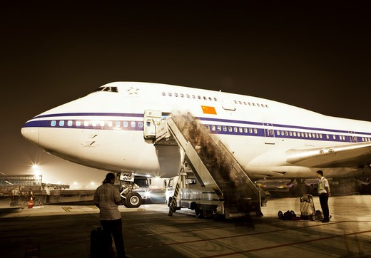 Stock Photo: 1891-288 People boarding Boeing 747, China