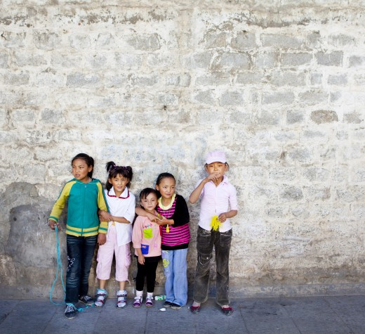 Stock Photo: 1891-291 Children standing in front of a stone wall, Tibet,