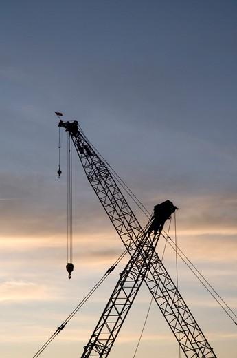 USA, Massachusetts, Boston, Industrial cranes silhouette : Stock Photo
