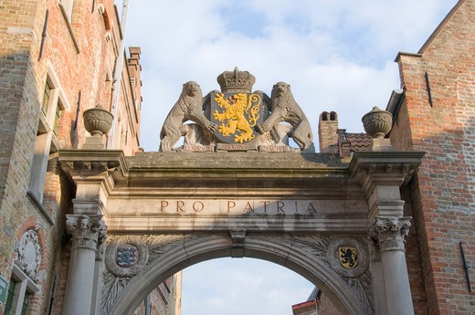 Coat of arms on an archway, Bruges, West Flanders, Flemish Region, Belgium : Stock Photo