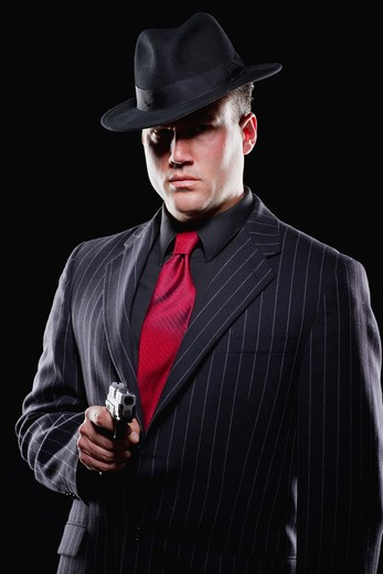 Stock Photo: 1894-225A Businessman aiming with a gun