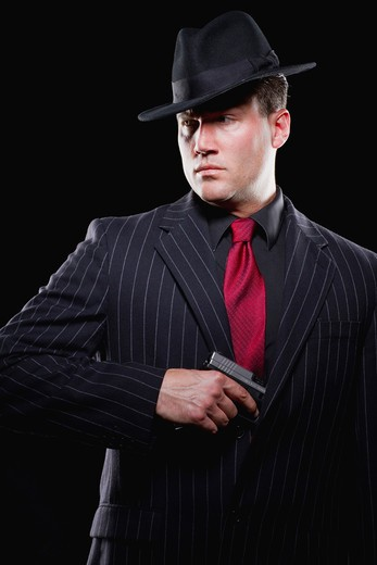 Stock Photo: 1894-225B Businessman taking out a gun