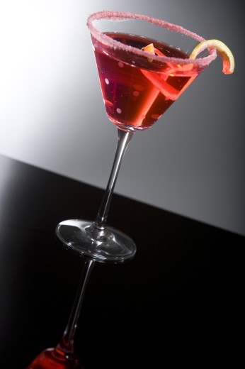 Glass of cocktail with a lemon peel : Stock Photo
