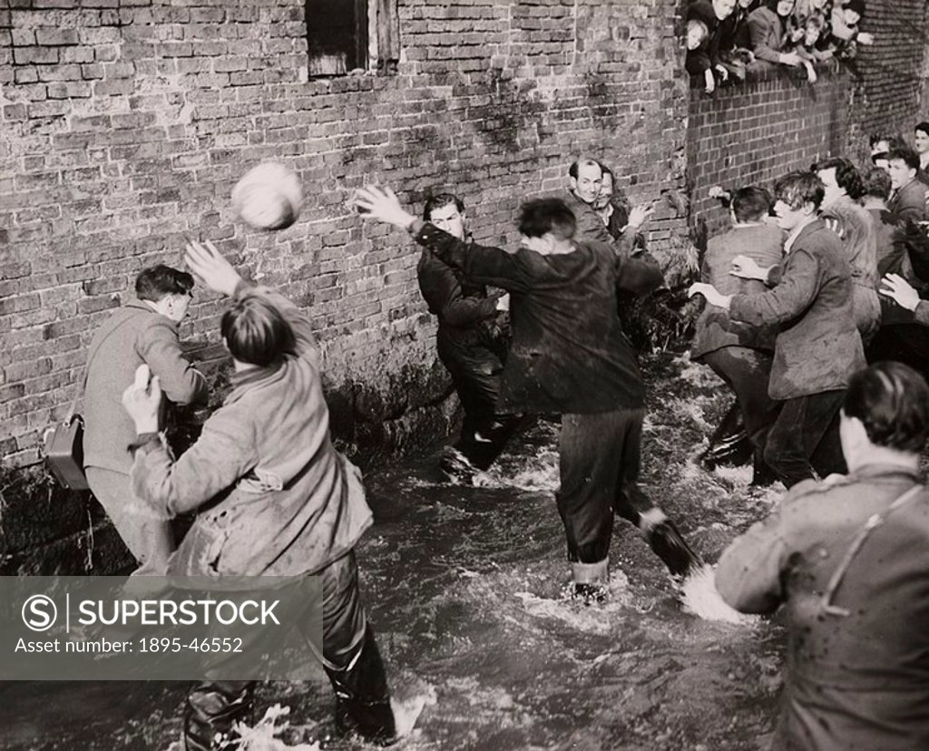 Stock Photo: 1895-46552 Gelatin silver print  A photograph of players fighting for possession of the ball in Henmore Brook during Shrovetide football in the village of Ashbou...