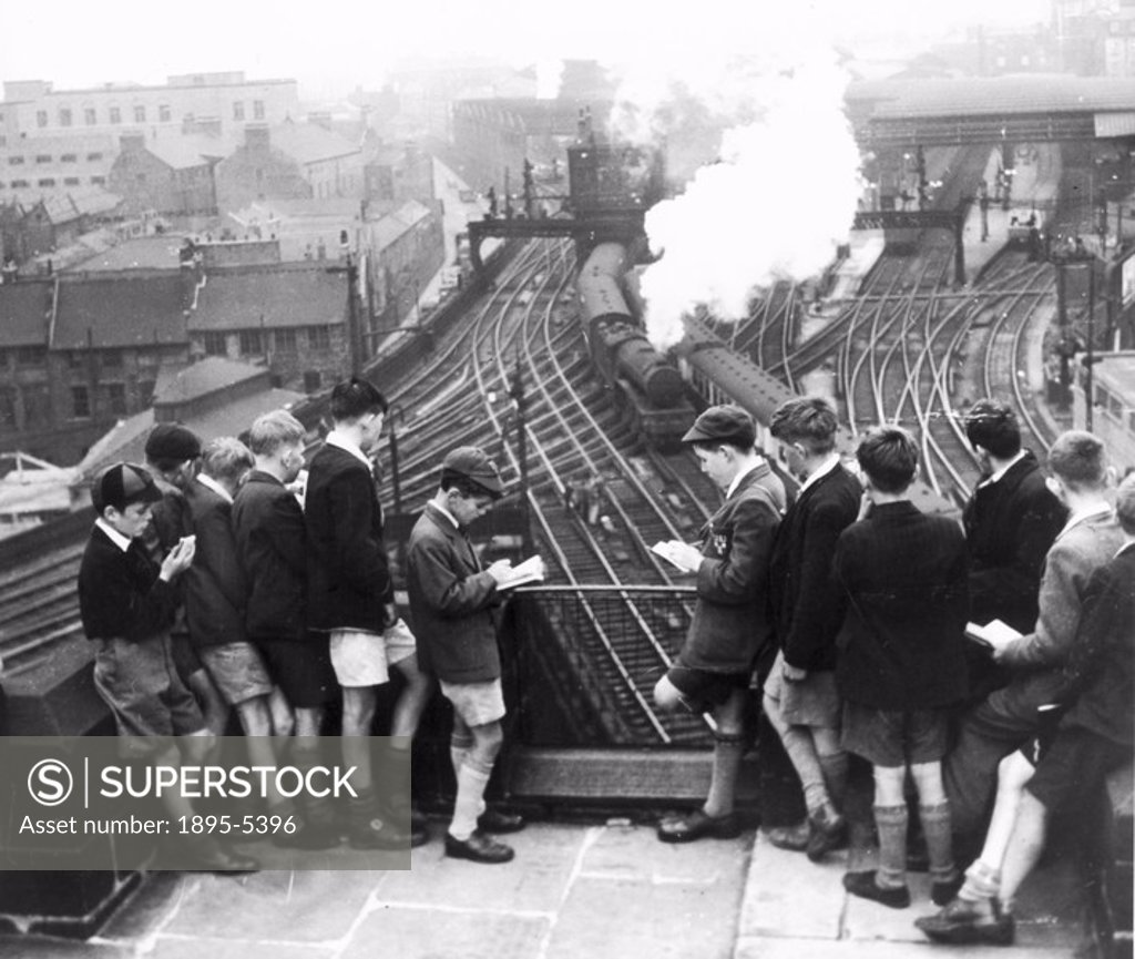 Stock Photo: 1895-5396 Schoolboy train-spotters at Newcastle Station, Tyne & Wear, August 1950