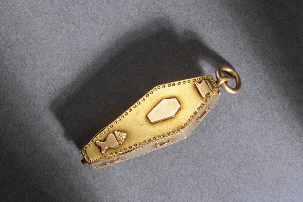 Stock Photo: 1895-11612 Skeleton in coffin pendant.