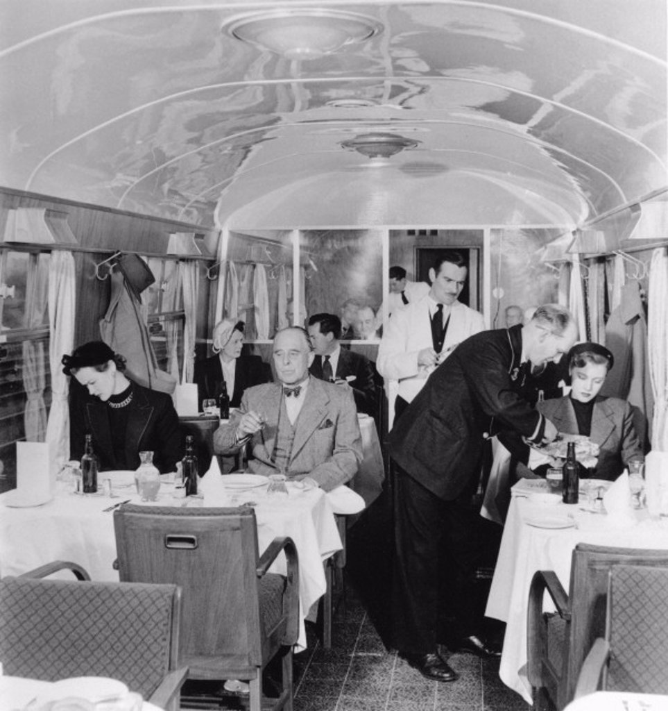 Stewards serving first class passengers, March 1951. : Stock Photo