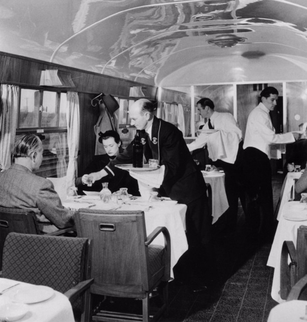 Stock Photo: 1895-11982 British Railways Stewards serving drinks in the First Class dining car, 1951.