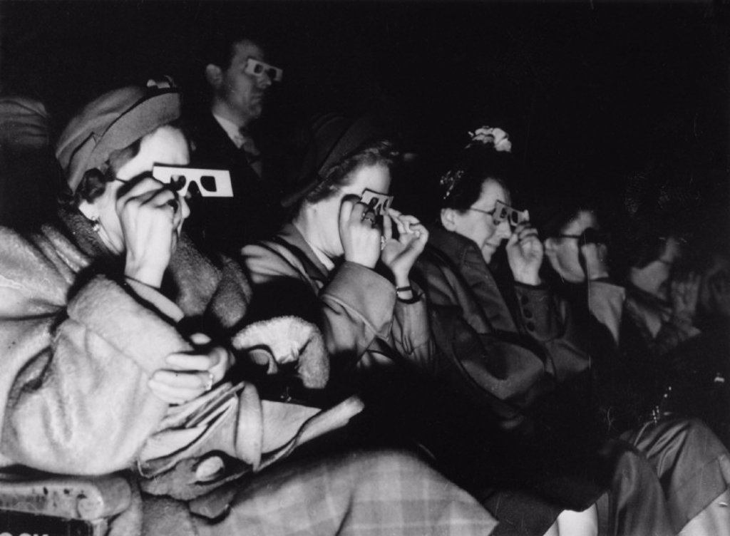 Audience watching a 3D film, c 1940s. : Stock Photo