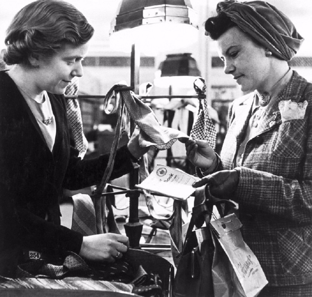 Shopping with clothing coupons, World War Two, c 1942. : Stock Photo