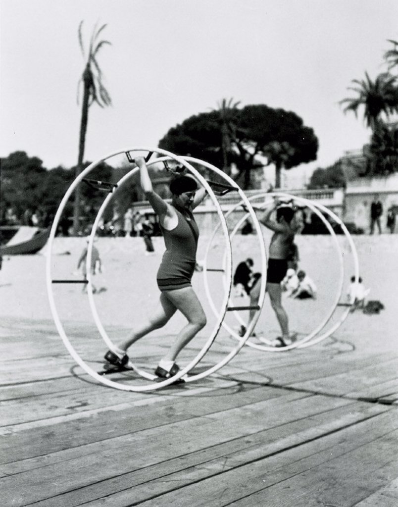 Couple using exercise wheels on a Florida beach, United States, c 1935. : Stock Photo