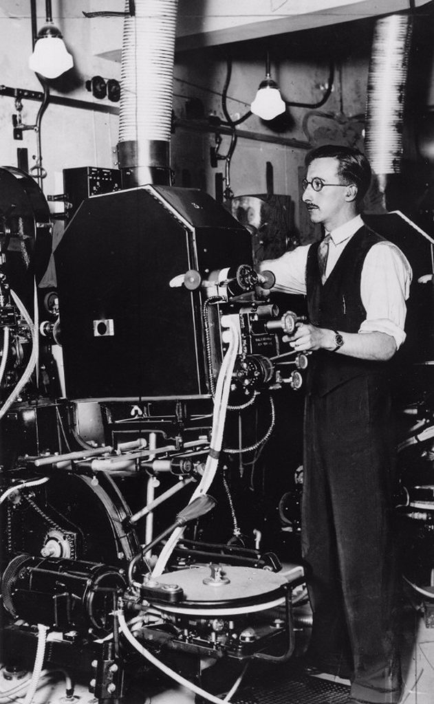 Cinema projectionist at work, January 1938. : Stock Photo