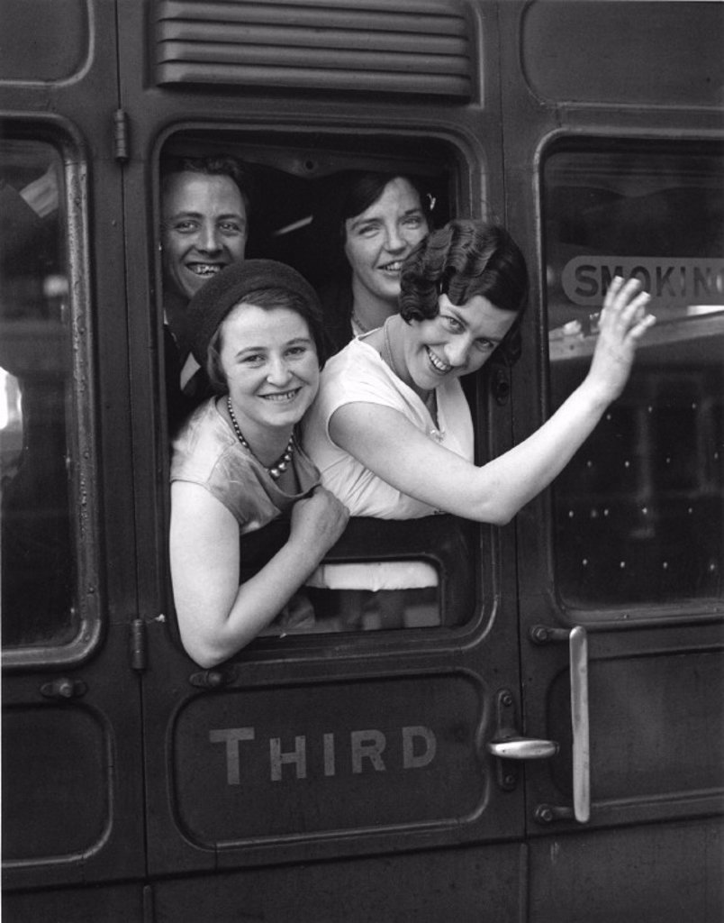 Stock Photo: 1895-15885 A group of young women looking out of a railway carriage, 3 July 1931.