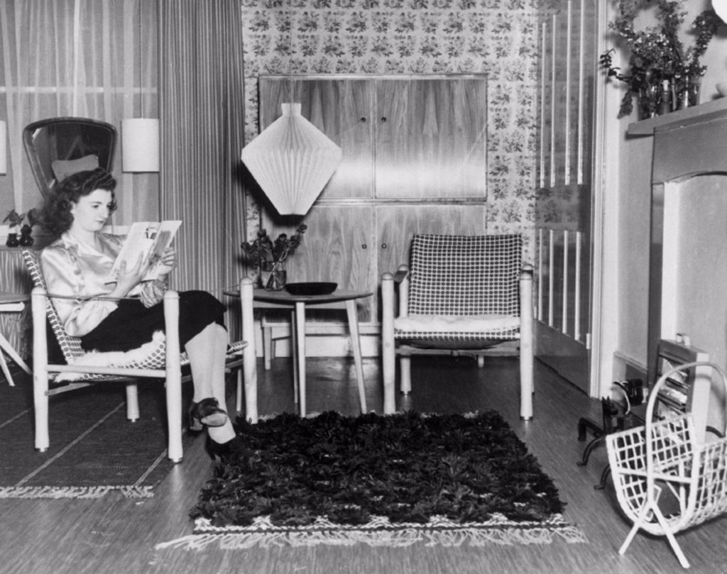A woman sitting in a prefabricated chair, 5 November 1946. : Stock Photo