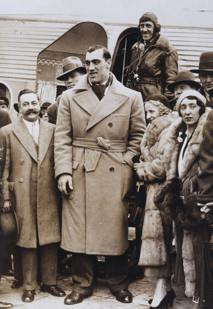 Primo Carnera arrives at Croydon Airfield, 9 March 1932. : Stock Photo
