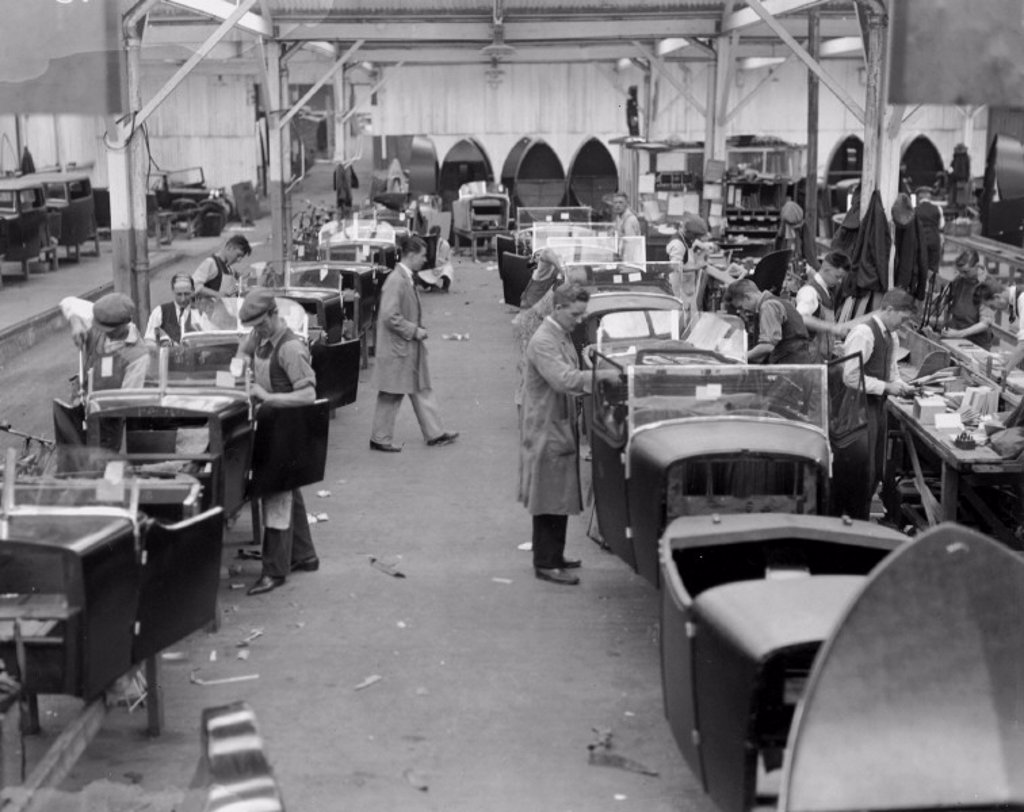 A production line at Lanchester Cars, Coventry, 22 September 1931. : Stock Photo