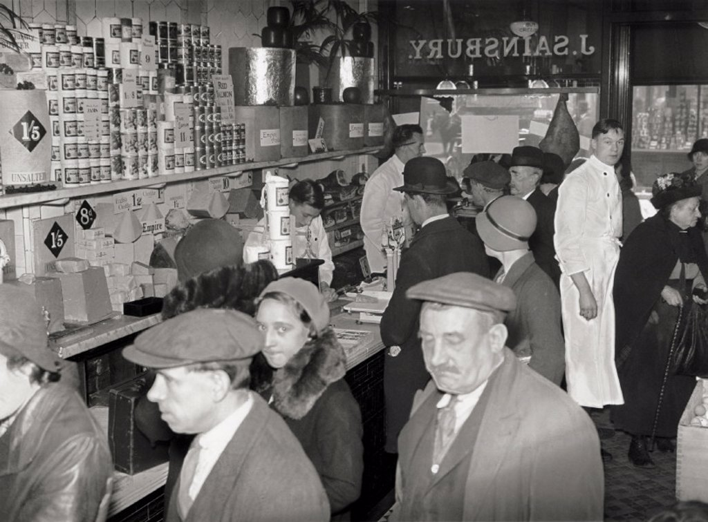Shoppers waiting to be served at a J Sainsbury store, October 1931. : Stock Photo