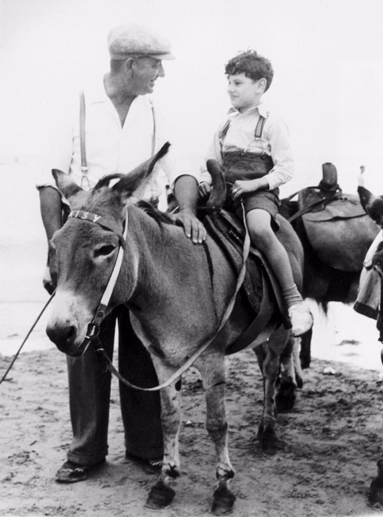Donkey riding at Margate, Kent, 3 August 1949. : Stock Photo