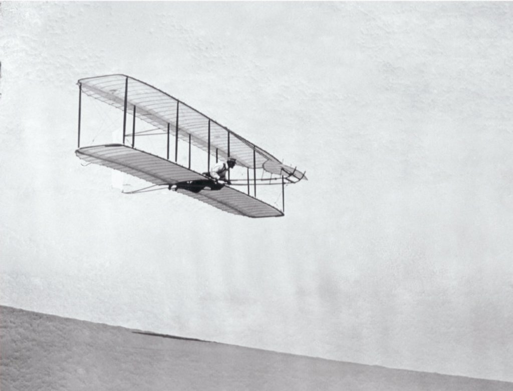 Stock Photo: 1895-21604 The Wright Brothers´ modified third glider in flight, 1902.