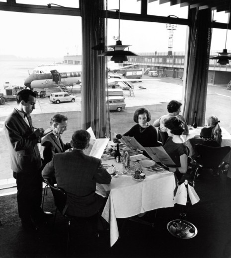 Manchester Airport, family in restaurant with BEA Vanguard behind, 1965. : Stock Photo