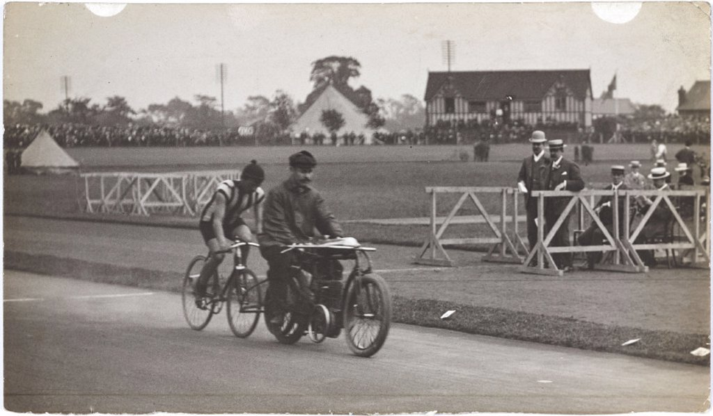 Stock Photo: 1895-26589 Cyclist being paced by a motorcycle, c 1912.