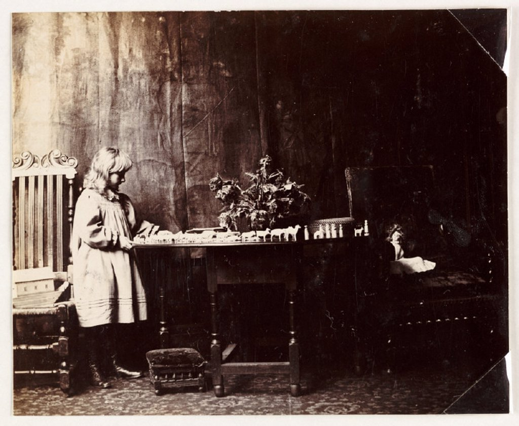 Girl playing with a Noah's Ark toy set, c 1905. : Stock Photo