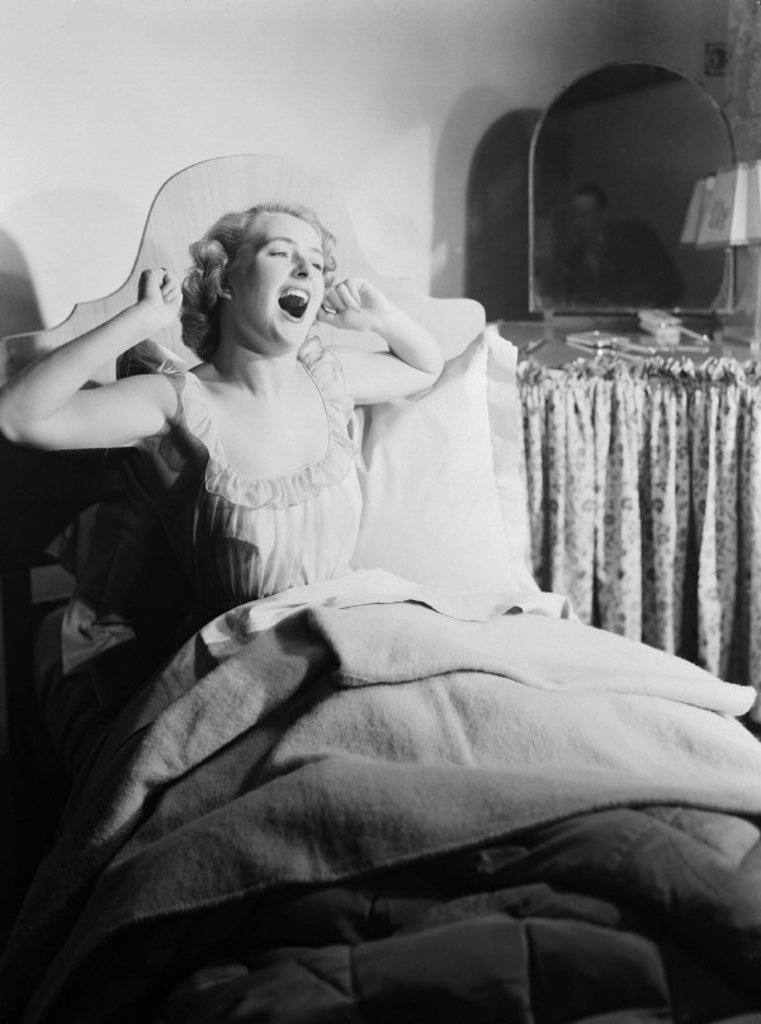 Stock Photo: 1895-30580 Woman waking up, 1952