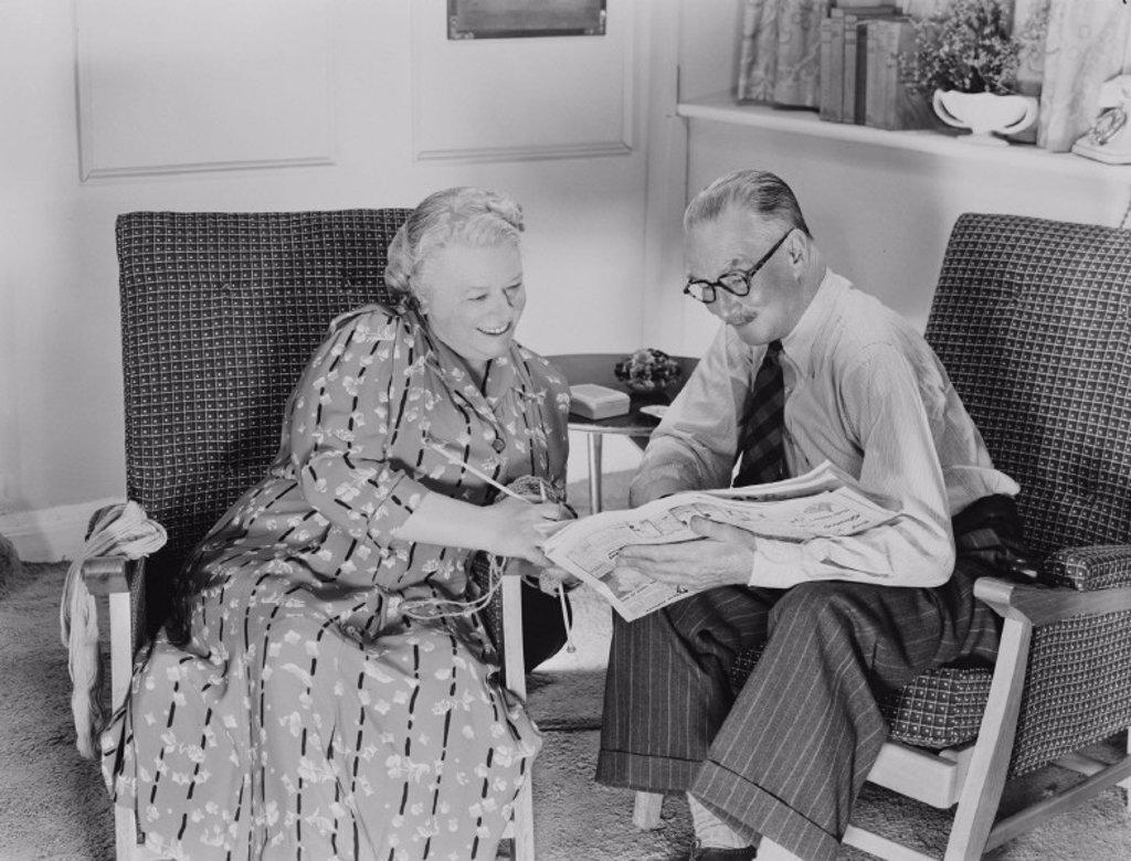 Elderly couple reading, c 1950 : Stock Photo