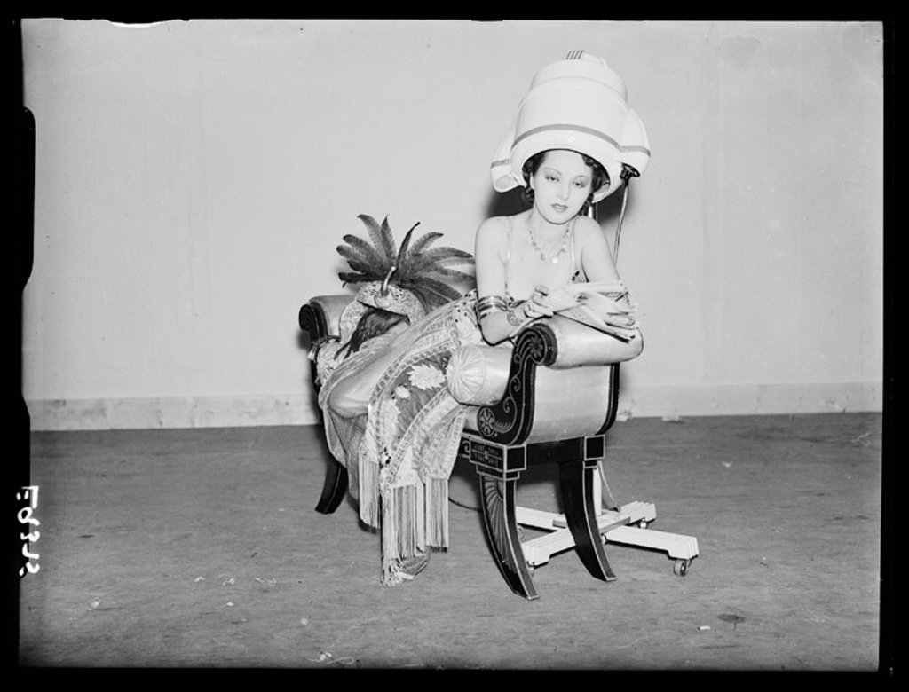 Woman under a hairdrier, 1930s. : Stock Photo