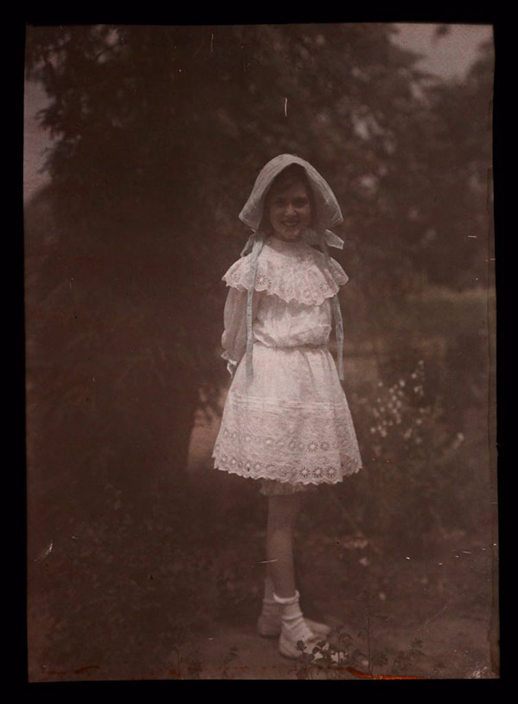 Girl wearing a bonnet and lace dress, 1908. : Stock Photo