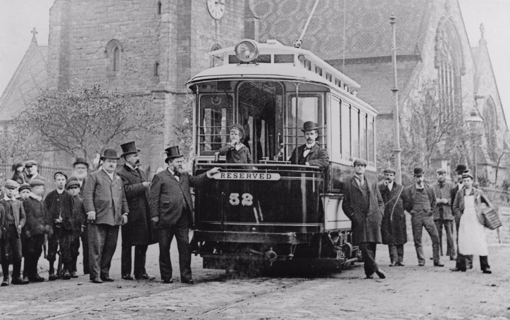 Stock Photo: 1895-33448 Men and children standing by a tram, c 1900s.