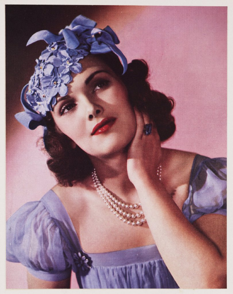 Stock Photo: 1895-34607 Woman modelling a hat, c 1940s.
