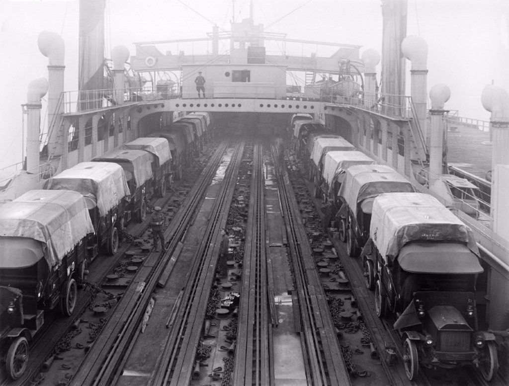 Road vehicles being loaded onto a ferry, 1918 : Stock Photo