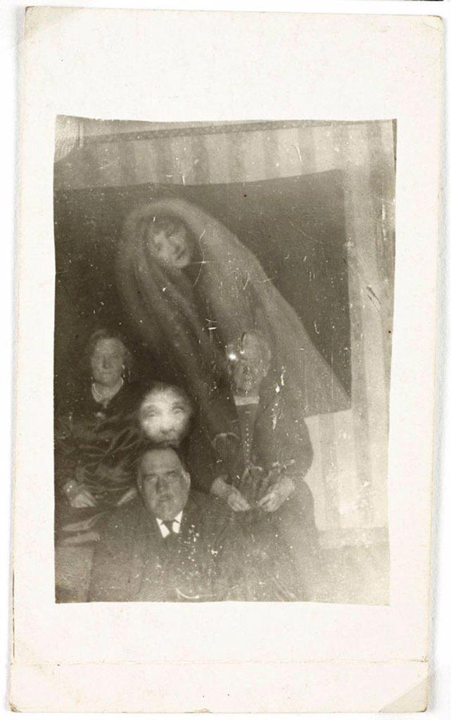 Three elderly people with two 'spirits', c 1920. : Stock Photo