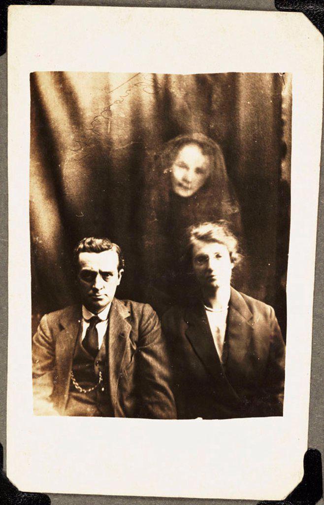 Stock Photo: 1895-40168 Couple with female 'spirit', c 1920.