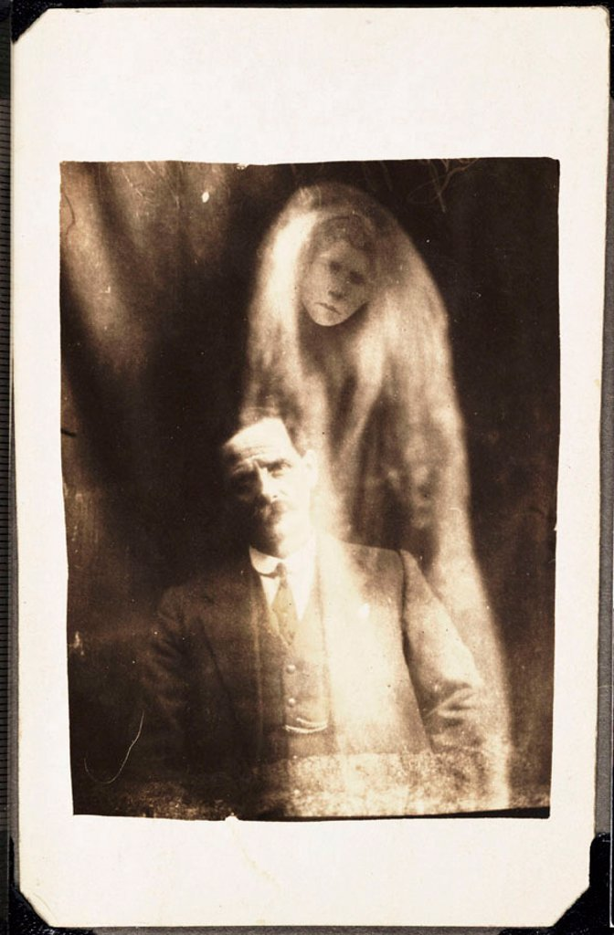 Man with 'spirit' of his deceased second wife, 1923. : Stock Photo