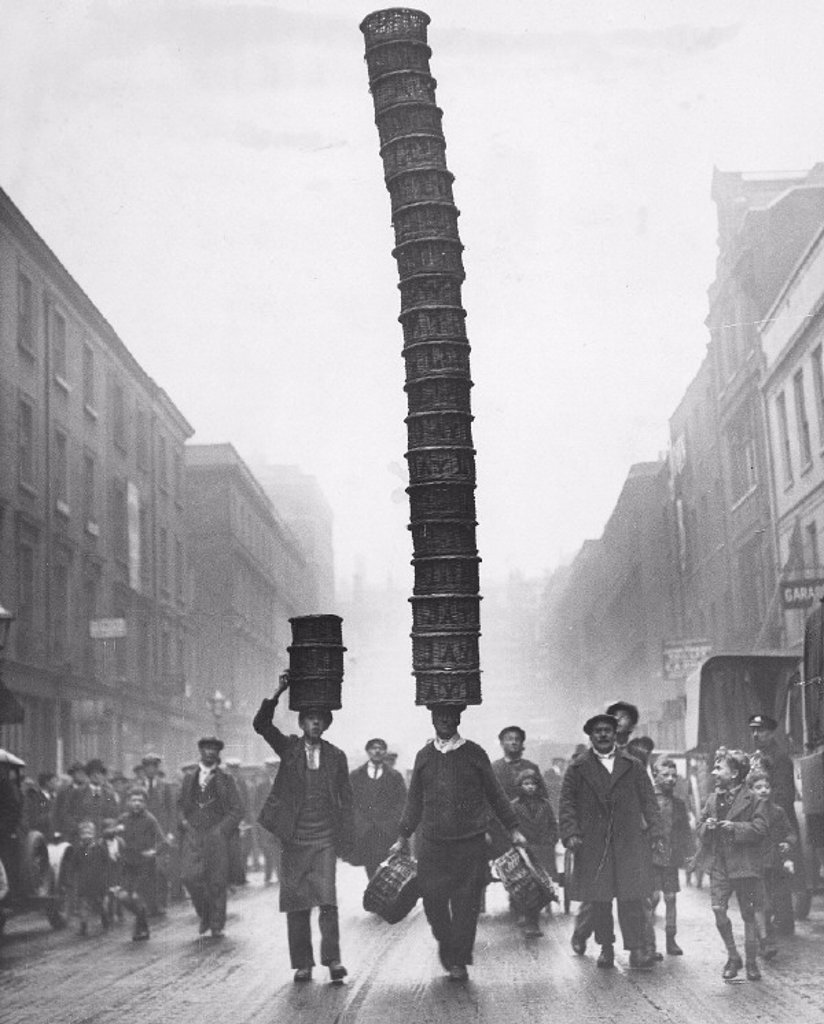 Covent Garden porter carrying a basket 'Eiffel Tower', 1928. : Stock Photo
