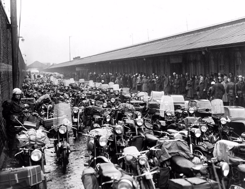 Motorcycles waiting to be loaded onto a ferry, Liverpool, June 1955. : Stock Photo
