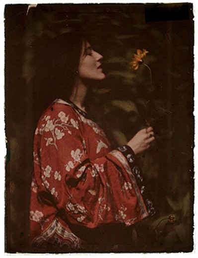 Stock Photo: 1895-45789 Woman in a kimono with a sunflower, 1908