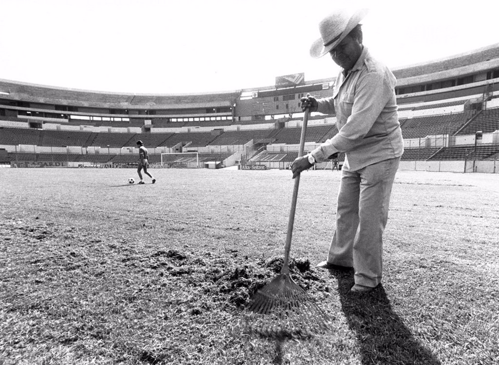 Stock Photo: 1895-48059 Raking the pitch in the football stadium, Monterey, Mexico, January 1986