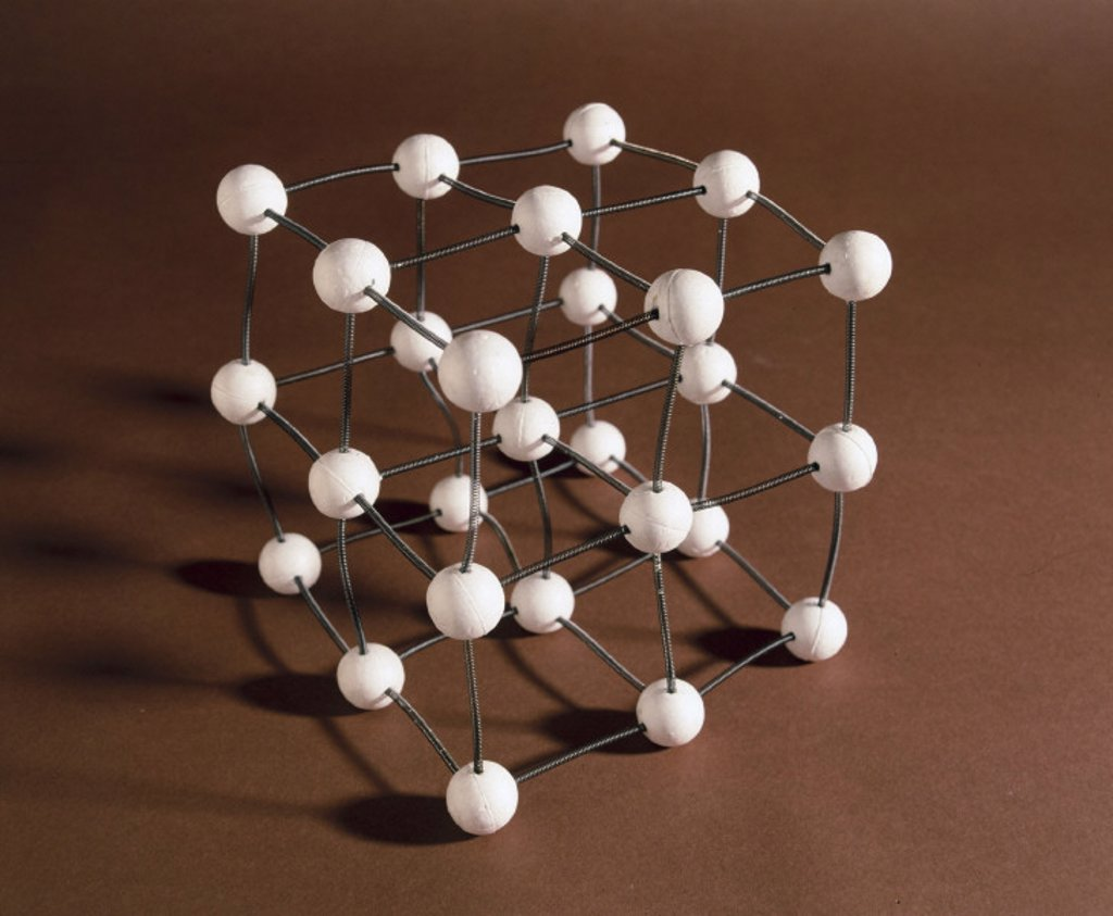 Model to demonstrate random vibrations of atoms in a crystal, c 1981. : Stock Photo