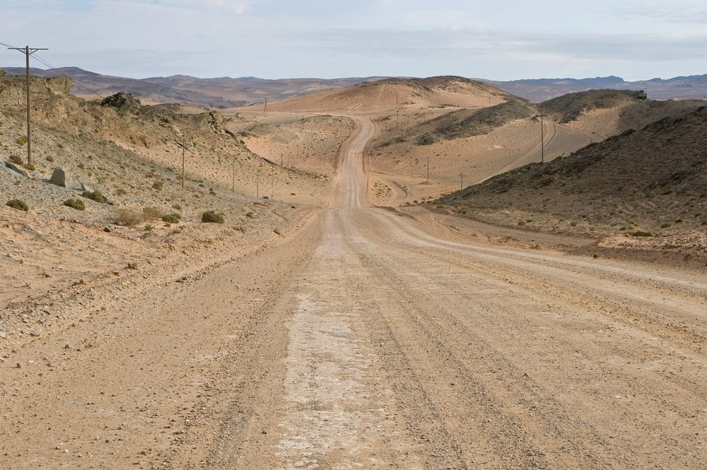 Gravel road running along Orange River and through diamond mining area, Northern Cape, South Africa : Stock Photo