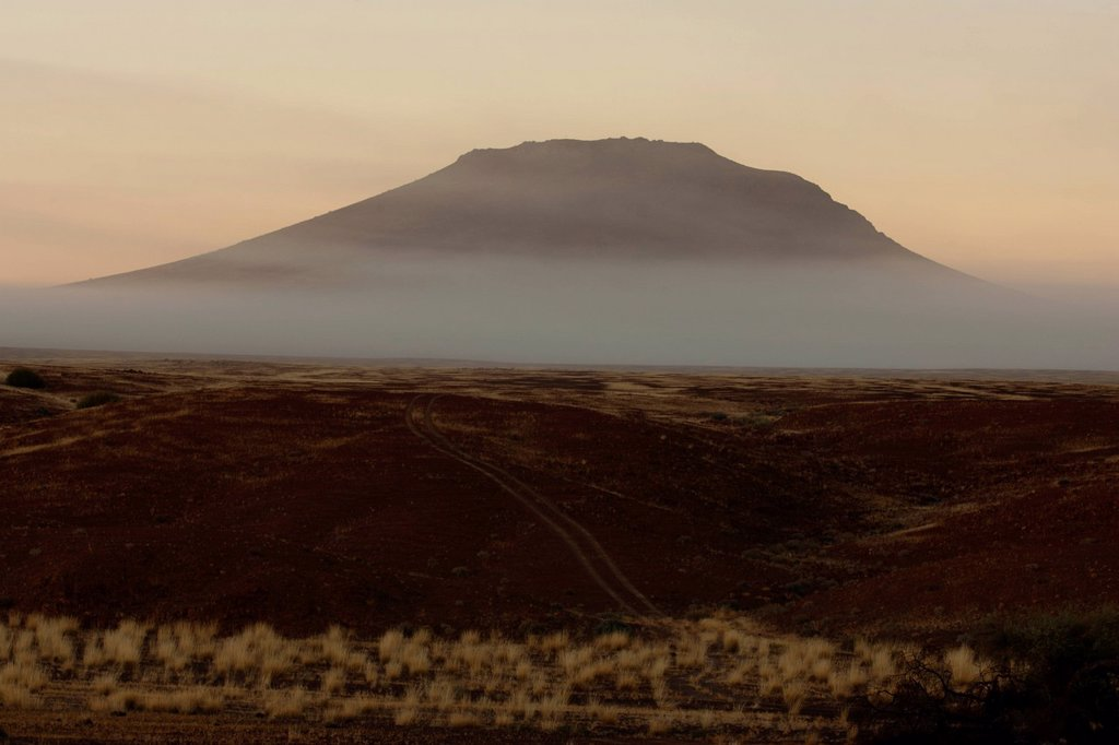 Mist hanging next to mountain, Namib Desert, Skeleton Coast, Namibia : Stock Photo