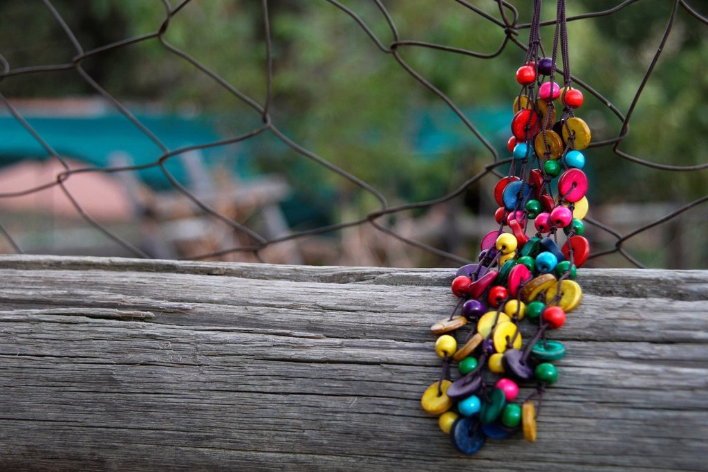 Stock Photo: 1896R-18499 Beaded Necklace hanging on a fence, Centurion, South Africa