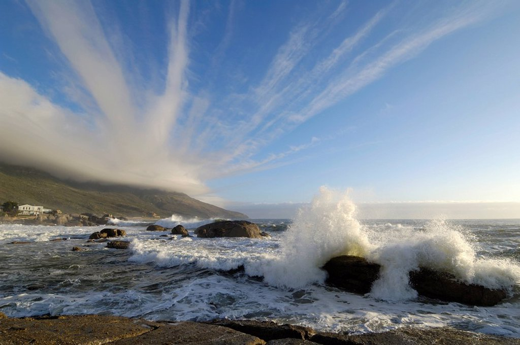 Strange Cloud Formations Emanate from the Table Cloth on the Twelve Apostles over the Bakoven Shoreline  Cape Town, Western Cape Province, South Africa : Stock Photo