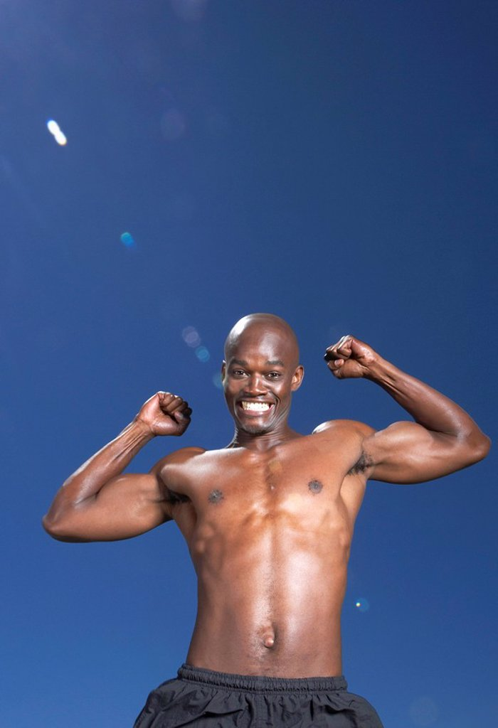 Portrait of a Shirtless, African Man Smiling  Cape Town, Western Cape Province, South Africa : Stock Photo