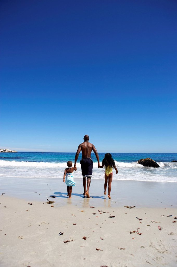 Afracan Man with his Children on the Beach  Cape Town, Western Cape Province, South Africa : Stock Photo